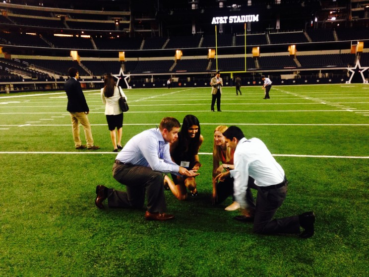 The Summer Associate Conference includes many fun activities, the 2014 intern class visited the Dallas Cowboys stadium for dinner and a behind-the-scenes tour. Here David and some fellow Summer Associates are drawing up a play, or perhaps discussing the virtues of PowerPoint.